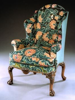 AN EXTRAORDINARY GEORGE II WALNUT WING ARMCHAIR