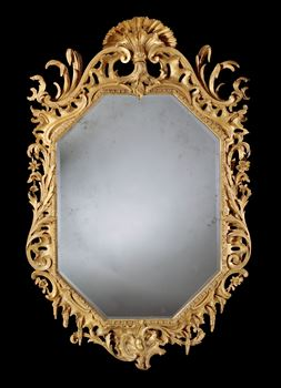 A MAGNIFICENT GEORGE II OCTAGONAL GILTWOOD MIRROR