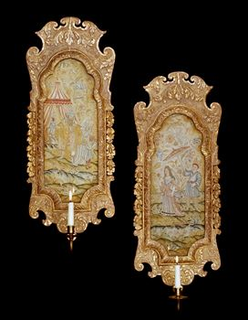 A PAIR OF QUEEN ANNE GILT GESSO SCONCES WITH NEEDLEWORK PANELS