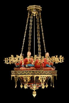 A REGENCY BRASS AND POLYCHROME JAPANNED COPPER TWENTY FOUR LIGHT CHANDELIER