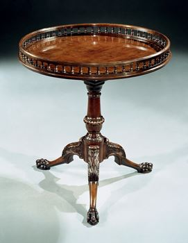 A GEORGE II CARVED MAHOGANY TRIPOD TABLE