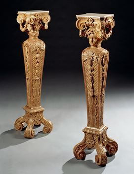 A PAIR OF GEORGE III CARVED GILTWOOD TERMS IN THE MANNER OF WILLIAM KENT AND ATTRIBUTED TO BENJAMIN GOODISON