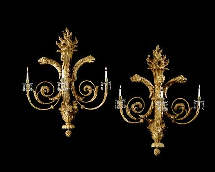 A PAIR OF REGENCY CARVED GILTWOOD WALL LIGHTS