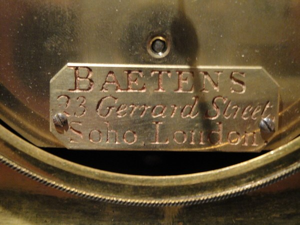 Detail of clock backplate with Baetens signature. Raffety Ltd.