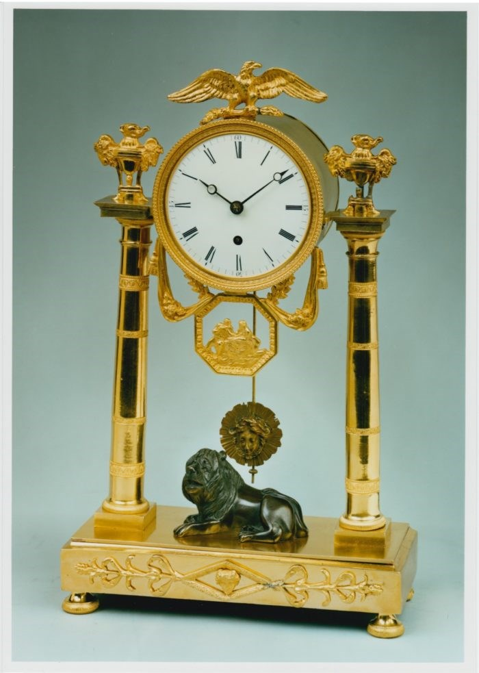 Mantel clock with bronze lion by Baetens, London. Raffety Ltd.
