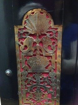 A detail of engraved brass side panels on a bracket clock – come and find it at the fair! Raffety Ltd.