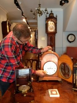 Andrej winds the clocks at Raffety Clocks, 79 Kensington Church Street. Photo by Tara Draper-Stumm