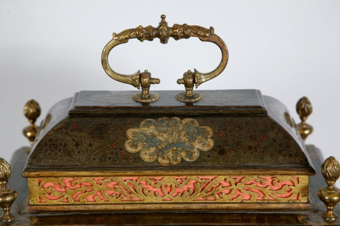 Detail of the caddy top of the clock by Simon du Charmes. Raffety Ltd.