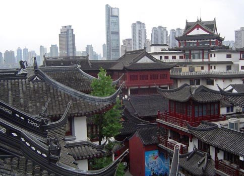 Rooftops of Old Shanghai and Modern Shanghai Office Towers.