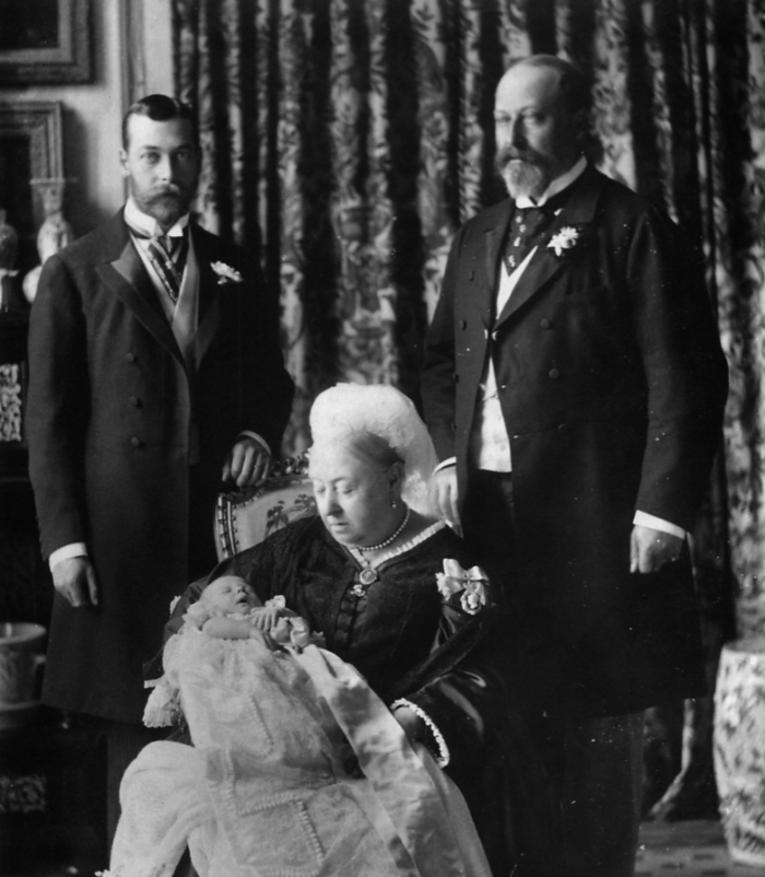 Photo of Queen Victoria with the future Kings Edward VII (right) and George V (left), then Duke of York and his baby son, the future Edward VIII