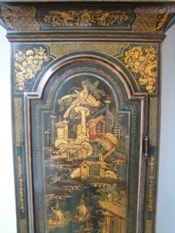 Detail of Chinoiserie lacquer decoration on a longcase clock by Monkhouse.