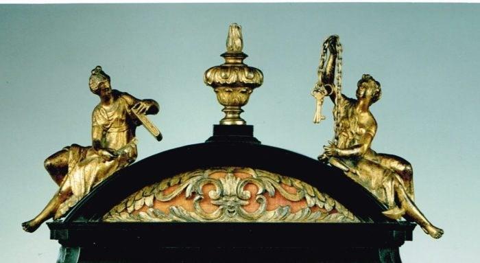Detail of Saints Basilisa and Anastasia on a Charles II period table clock. Raffety Antique Clocks