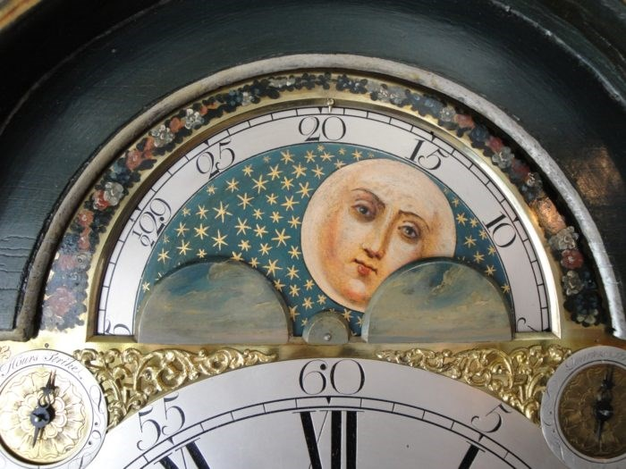 Detail of a clockface with moon phase. Raffety Antique Clocks
