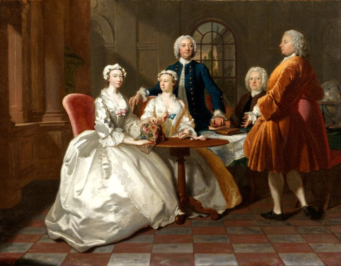 A Conversation Piece by Joseph Highmore. Typical of portraits of the period, the family is shown in an interior undertaking various pursuits. Two tripod tables (one covered with a table cloth) are being used for sewing and reading. Copyright Christie's.