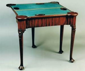 Detail of the mahogany games table, showing the baize covered card table. Circa 1740. Raffety Ltd.