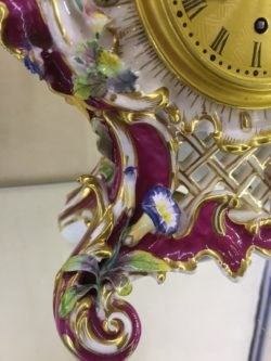 Detail of scrolled foot, with gilding, finely modelled foliage and flowers.