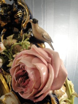 Detail of bird and naturalistic handcrafted and handpainted rose.