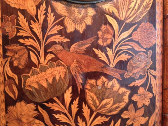 Detail of marquetry decoration on longcase clock by Carolus Cabrier, with bird and flowers. Raffety Ltd