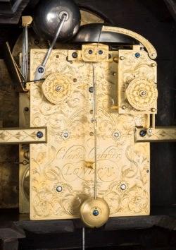 Detail of backplate on bracket clock by Charles Cabrier II. Raffety Ltd