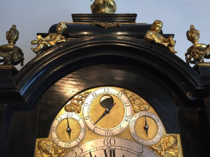 Detail of the subsidiary dials and moonphase in the arch on a bracket clock by Charles Cabrier II. Circa 1730. Raffety Ltd