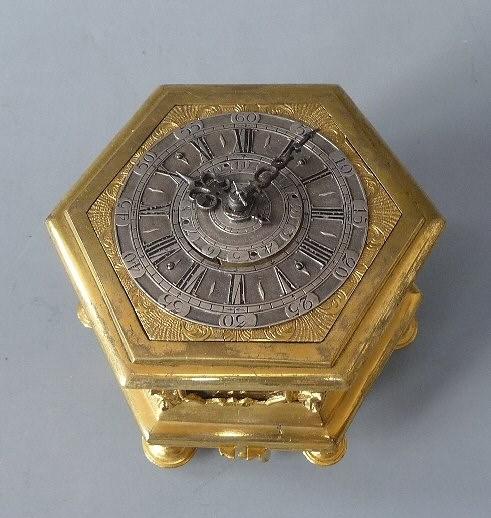 Silver & gilt hexagonal table clock signed Cabrier, London. Circa 1760. Courtesy Van Dreven Aniquair.