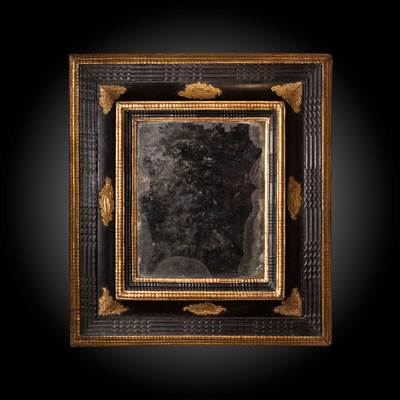 An ebonized and gilded wood mercury mirror, North of Italy, early 18th century (57 cm high, 51 cm wide)