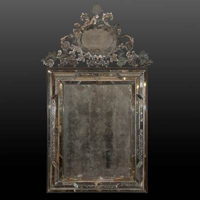 An important rectangular mirror with its top, Murano, Venice, Italy, early 18th century (204 cm high, 105 cm wide)